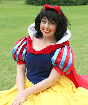 With her dark hair and far white complexion, our Apple Princess is a classic attraction at any princess party