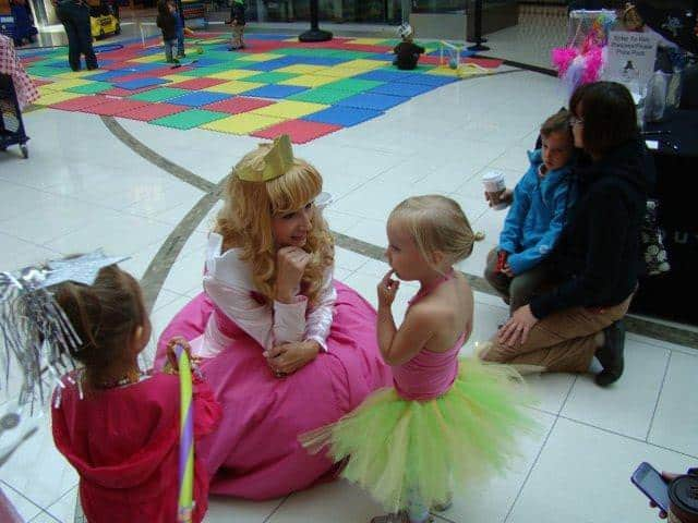 Princess Sleeping Beauty chatting with star struck toddler at Calgary Southcentre Mall