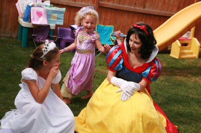 Princess Snow White participating in an outdoor game at a 3rd old princess birthday party in Calgary