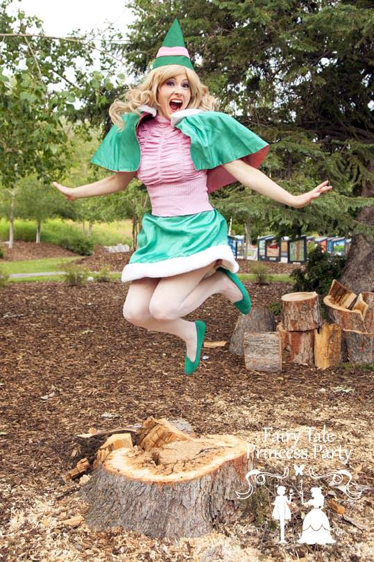 Jumping for Joy Christmas Elf excited about XMAS parties