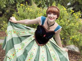 Snow Princess in her lovely and colourful Coronation Dress in a deep curtsey