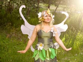 Generic Green Fairy with her delicate white wings before a Calgary children's event to celebrate the changing of the seasons.
